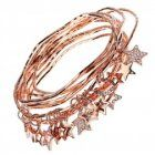 Amazing set of nine crystal and Rose Gold star charm bangles